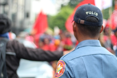 A policeman looks on as protesters line up for the march.