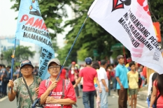 Women from farmer's groups support the worker's call for just wages and job security.