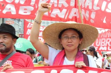 GABRIELA Women's Party Representative Arlene Brosas raises her fist to end contractualization.