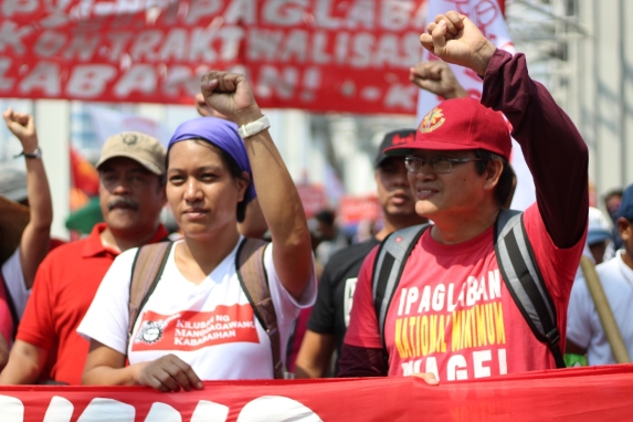 Gabriela secretary general Joan May Salvador and government employee union leader Ferdinand Gaite joined the workers call for greater state protection of workers.