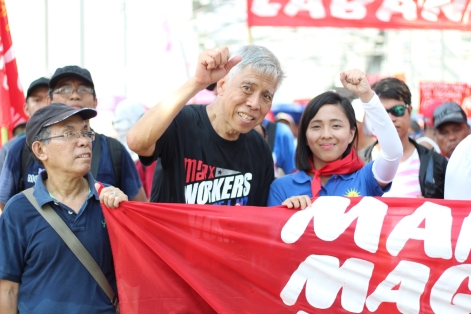 NDFP peace consultant Alan Jazmines and Kabataan Partylist Representative Sarah Elago at the International Worker's Day in the Philippines.